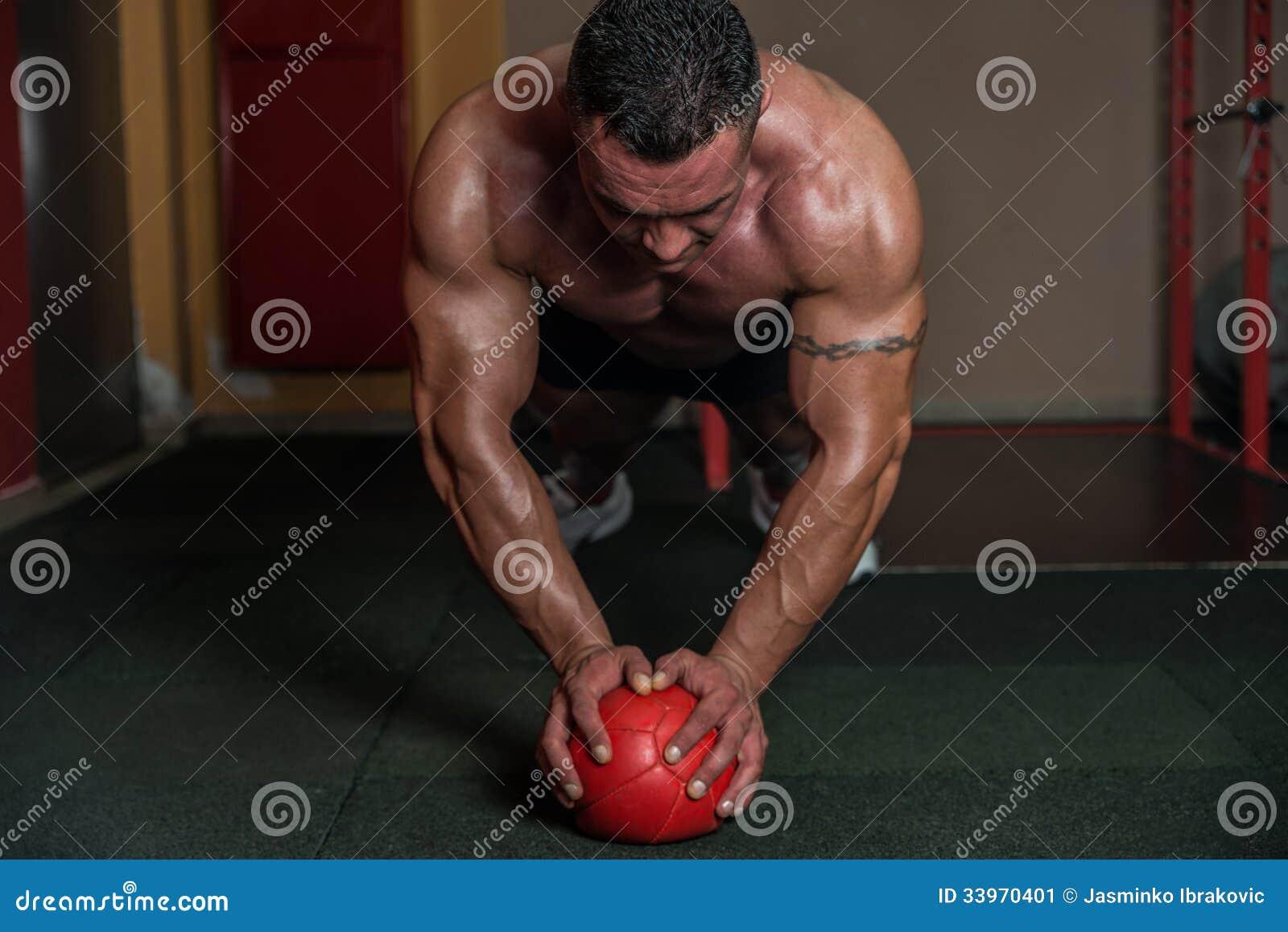 Push-ups On Medicine Ball Stock Image - Image: 33970401