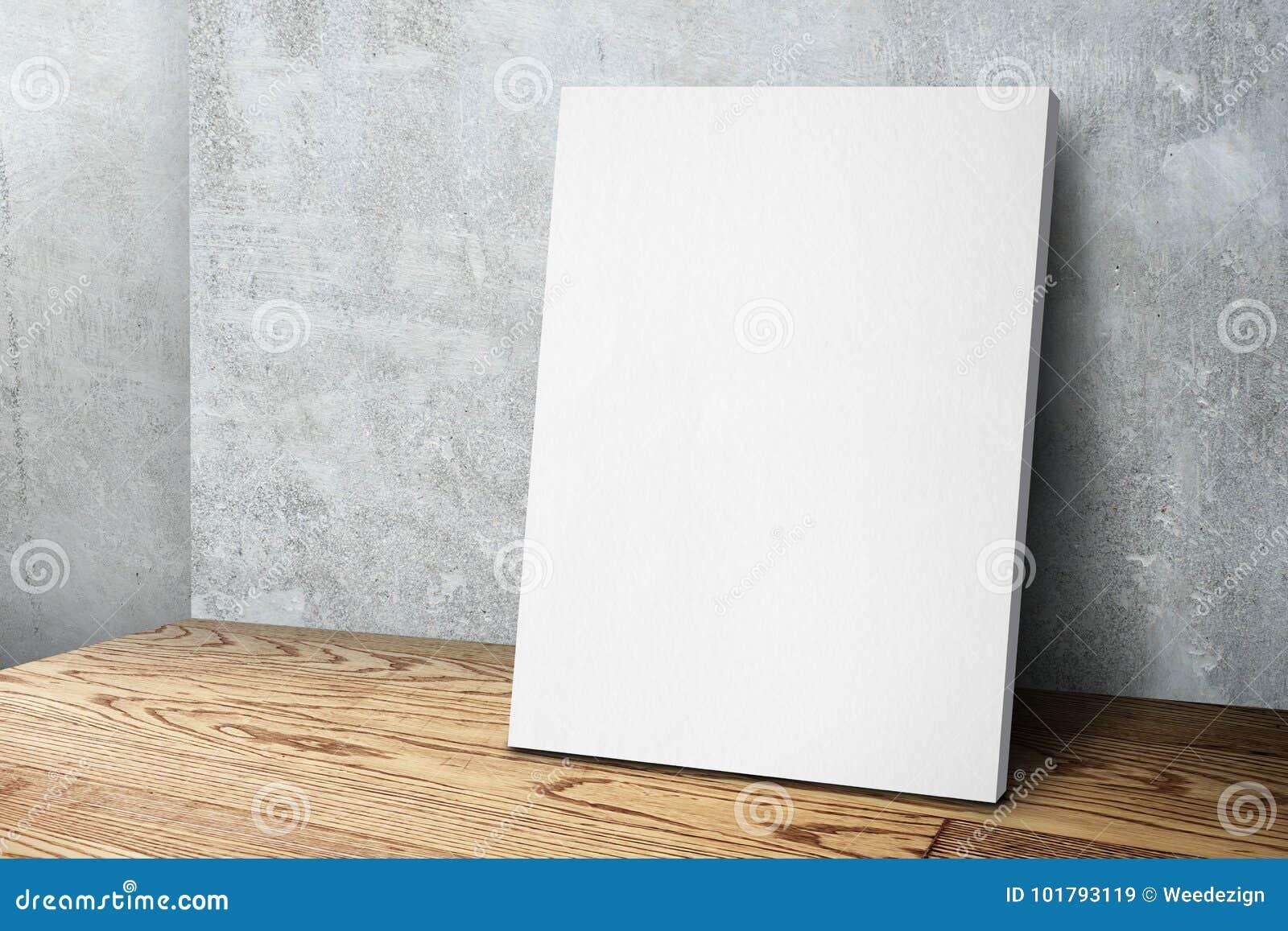 Pusta biała kanwy rama opiera przy betonowej ściany i drewna podłoga