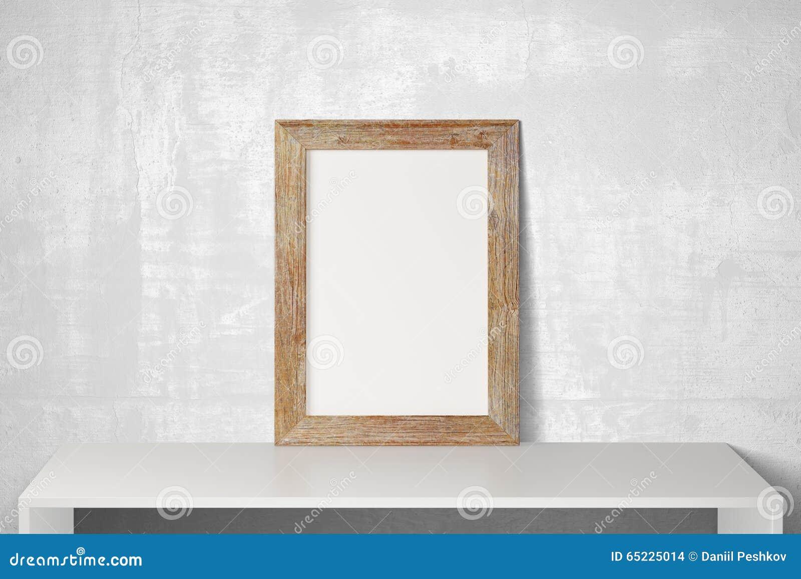 Pusta drewniana obrazek rama na bielu stole i beton podłoga, mo