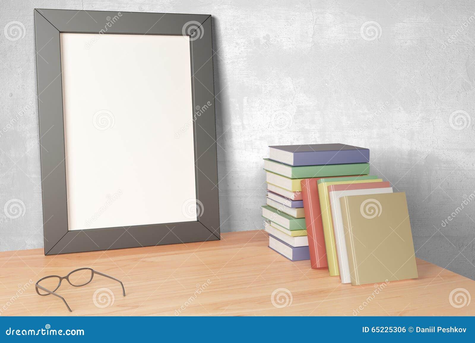 Puste miejsce obrazka popielata rama na drewnianym stole z eyeglasses i pil