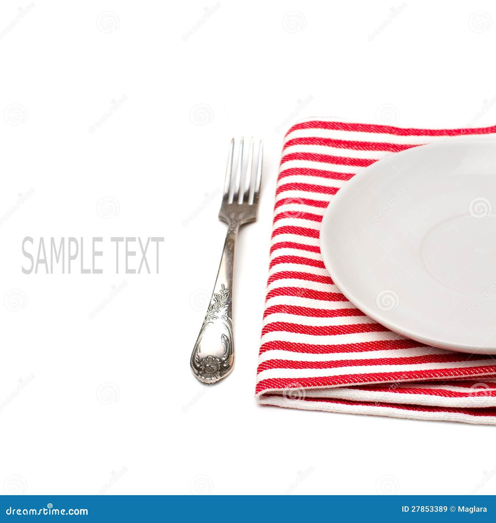 Pusty biel talerz na tablecloth z rozwidleniem