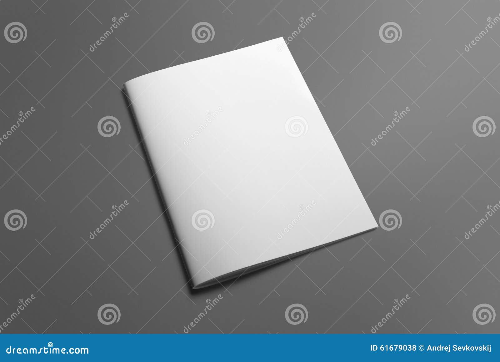 Pusty broszurka magazyn na popielatym zamieniać twój projekt
