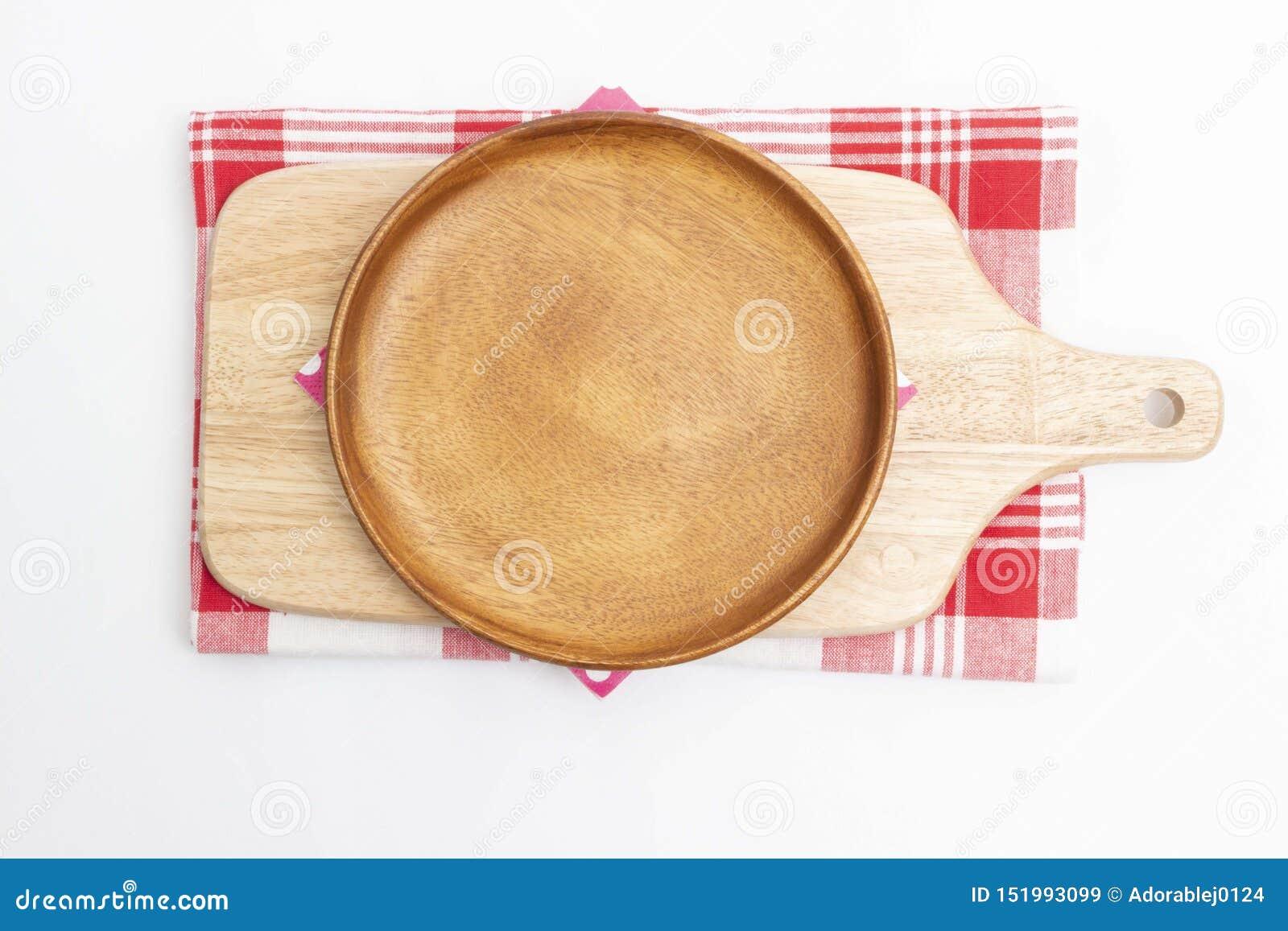 Pusty drewniany naczynie i drewniana tnąca deska