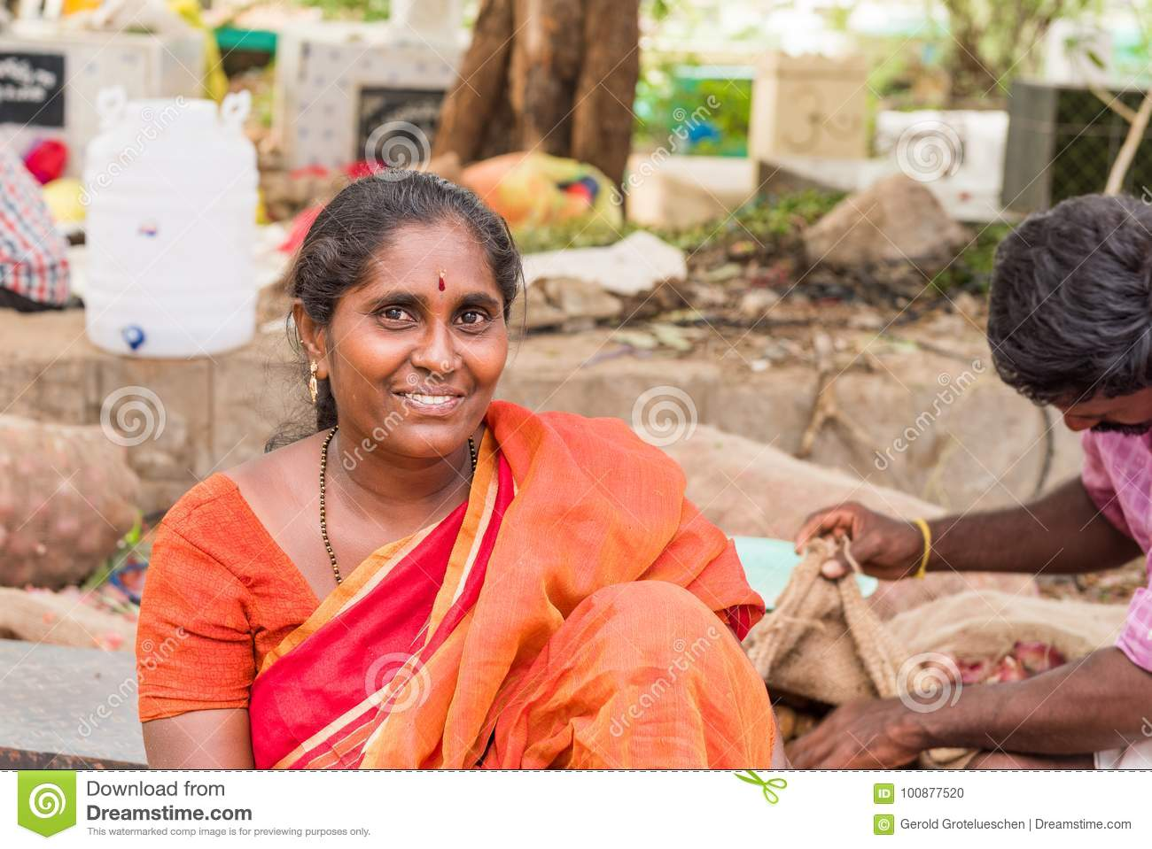 PUTTAPARTHI, ANDHRA PRADESH - INDIA - JULY 22, 2017: Portrait of an indian woman outdoors. Copy space for text.