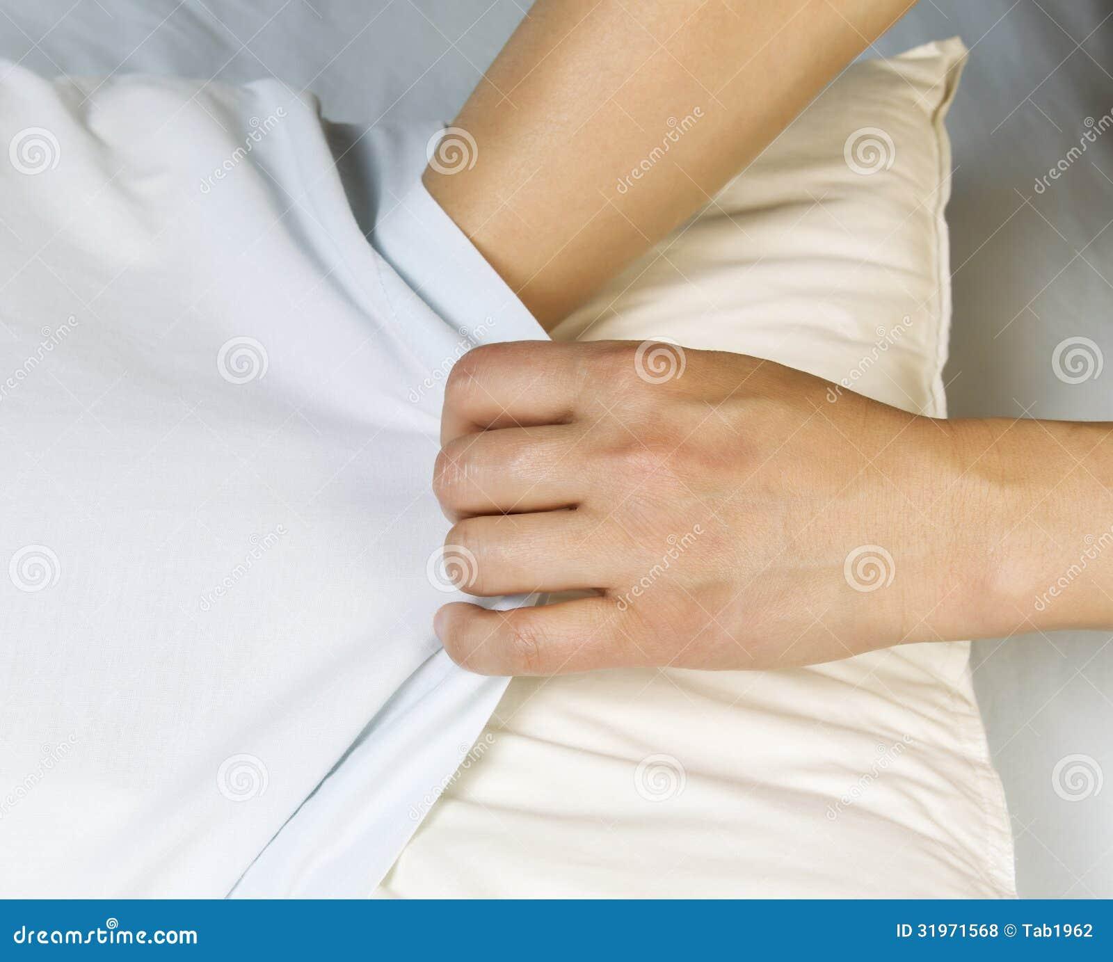 putting clean pilllow case on pillow stock photo image of mattress