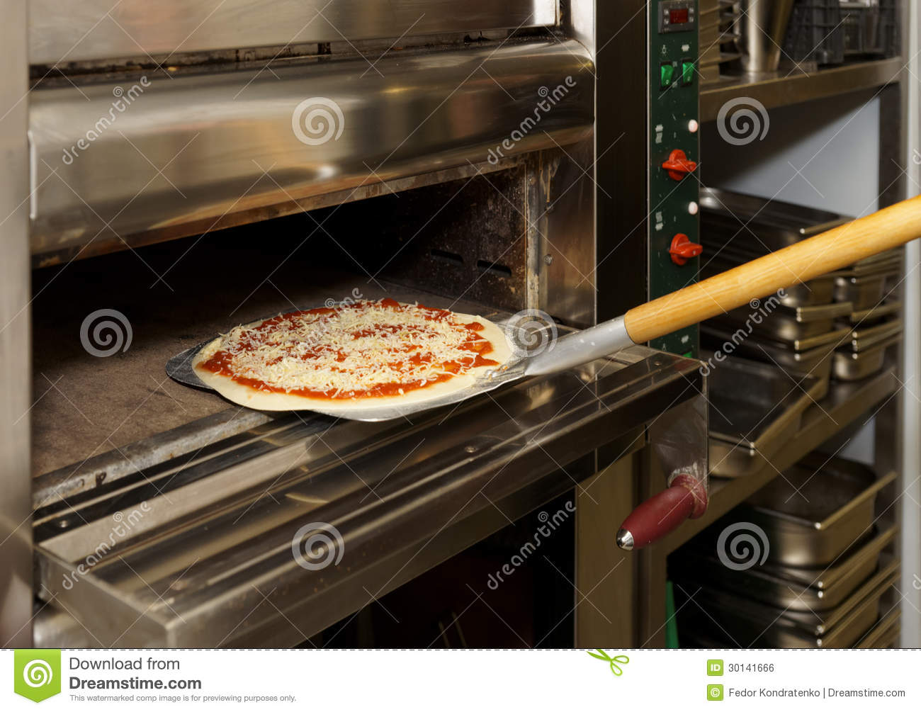 Putting Pizza In Oven Royalty Free Stock Image Image