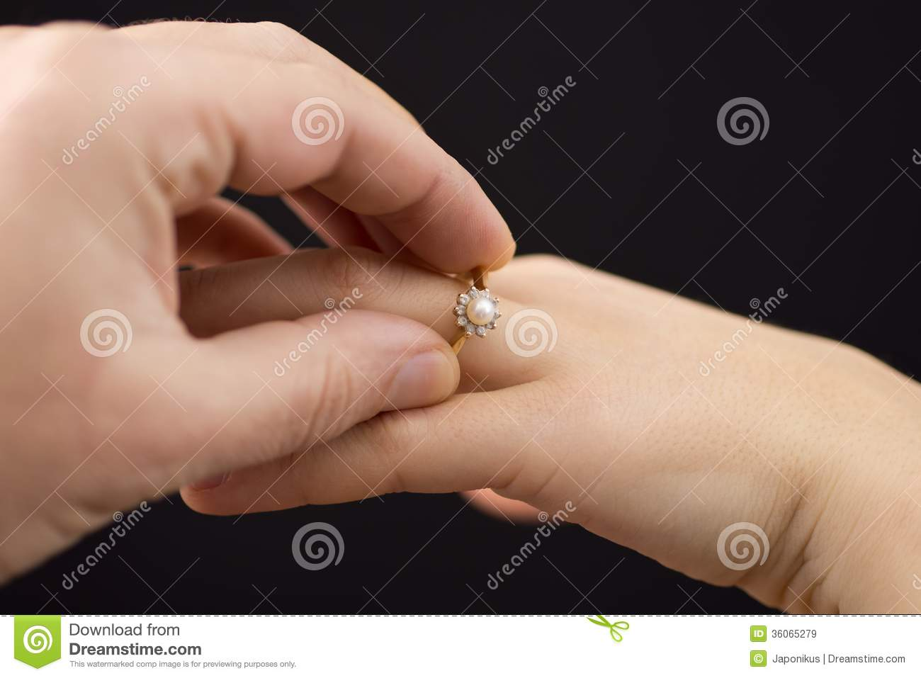 Putting A Ring On Girl\'s Hand Stock Image - Image: 36065279