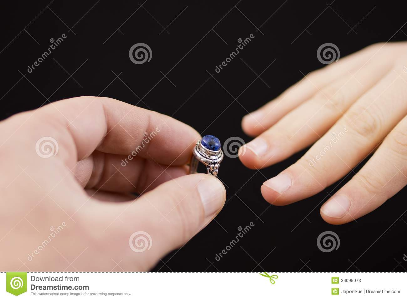 Putting A Ring On Girl\'s Hand Stock Image - Image: 36095073