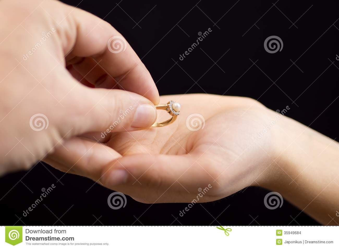Putting A Ring In Girls Hand Stock Photo - Image of isolated, hand ...