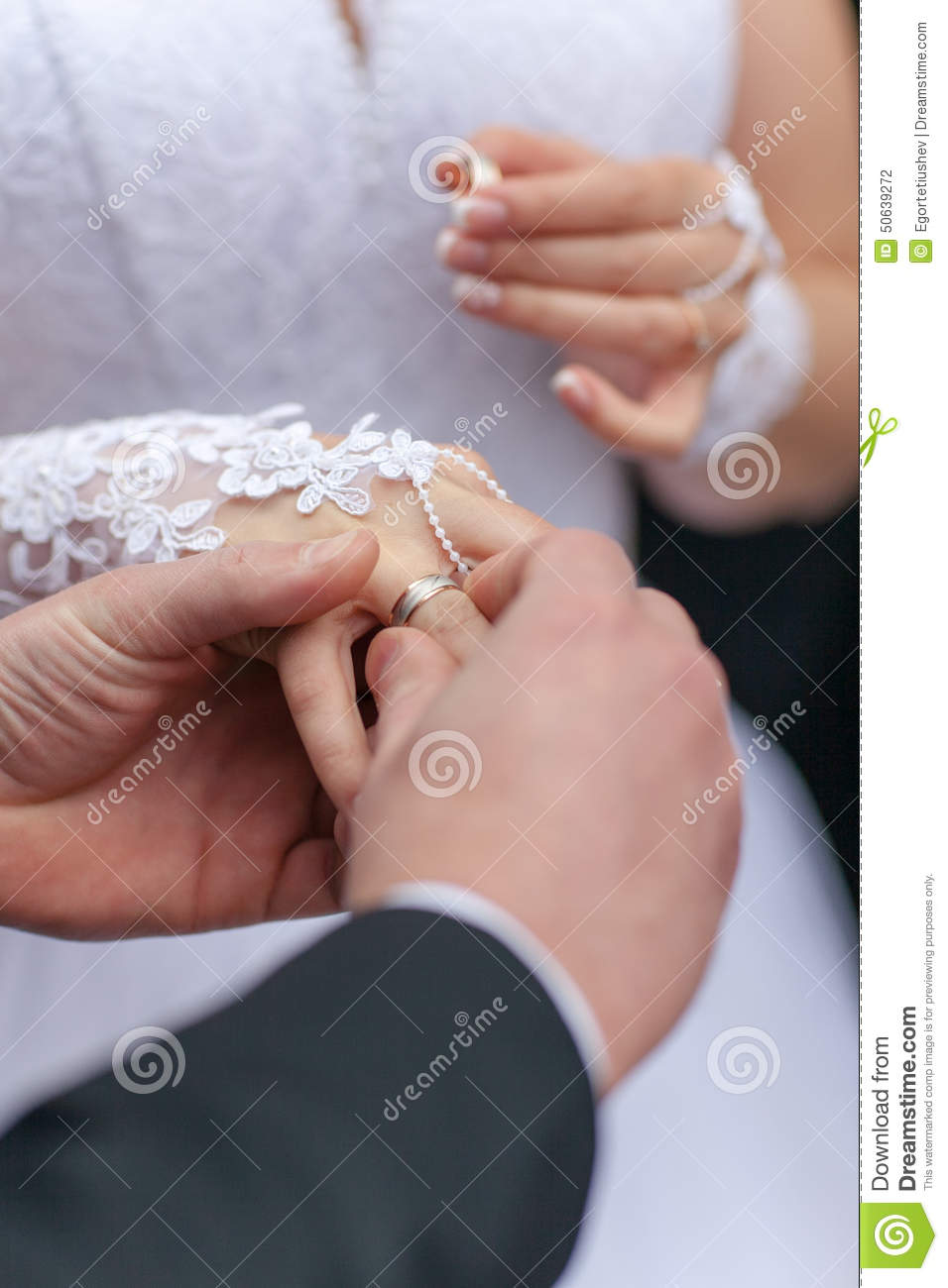 Putting the wedding ring stock photo. Image of married - 50639272