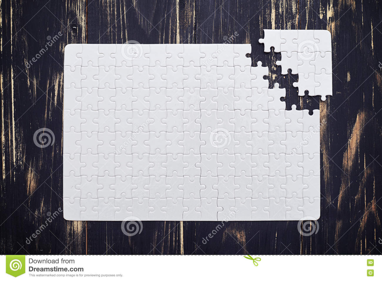 Puzzle close to soltion on dark wooden desk