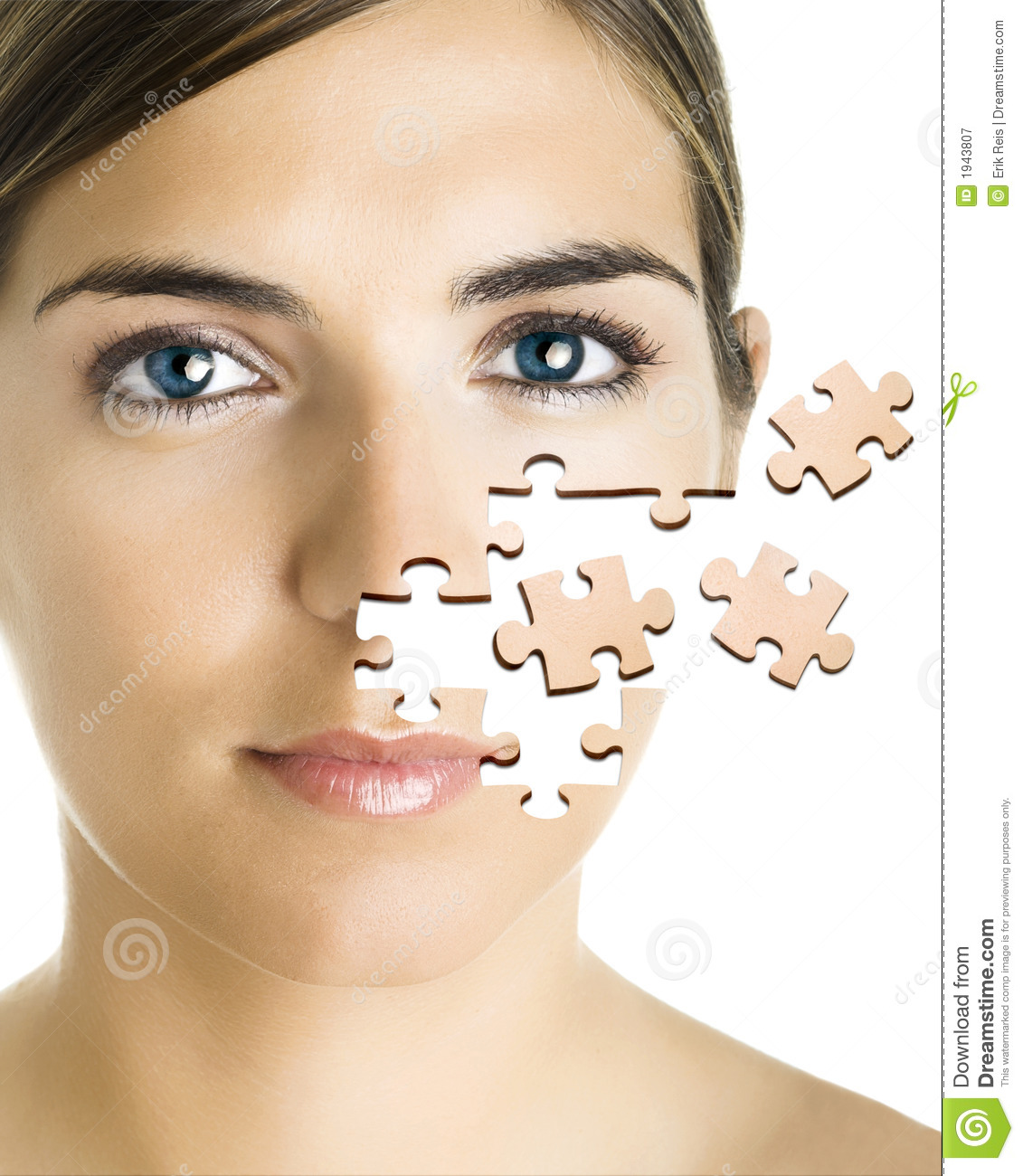 Concept image of a beautiful young woman with puzzle pieces on her