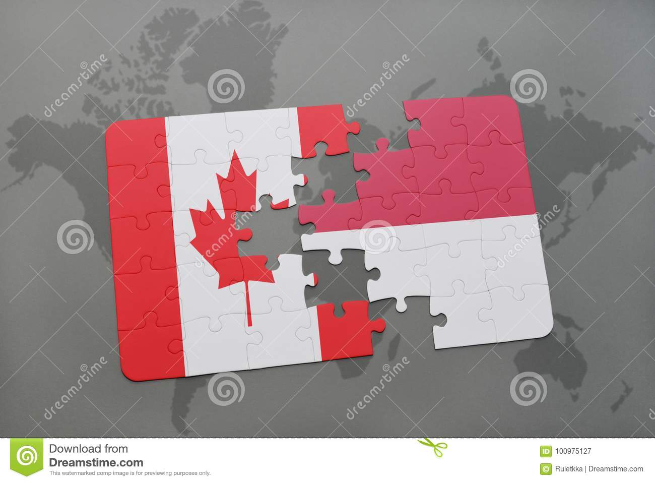 puzzle with the national flag of canada and indonesia on a world map background.