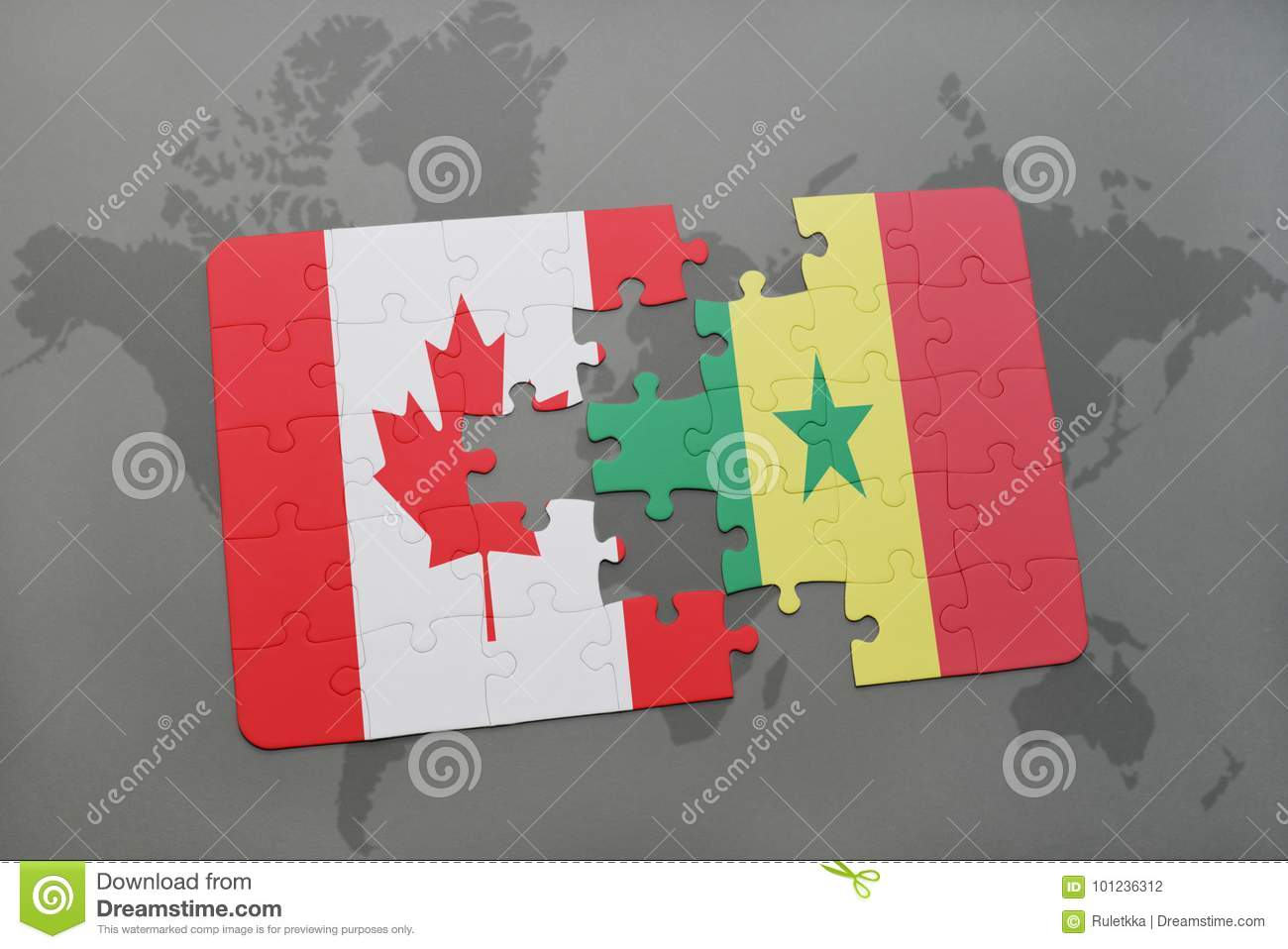 Puzzle With The National Flag Of Canada And Senegal On A ... on