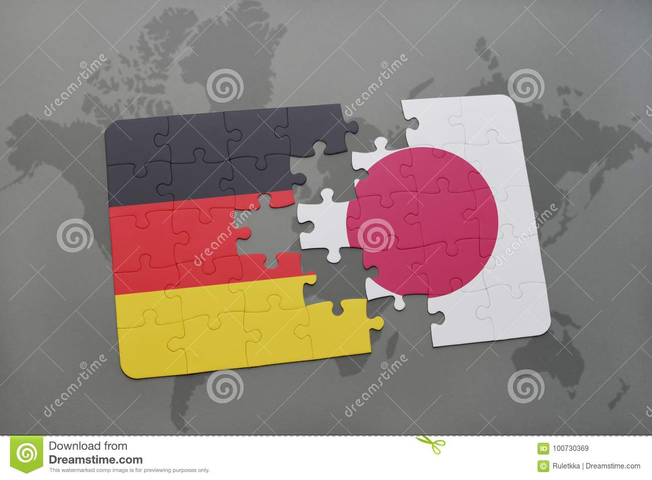 puzzle with the national flag of germany and japan on a world map background.