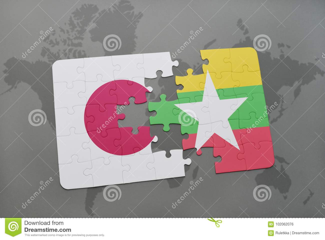 puzzle with the national flag of japan and myanmar on a world map background.