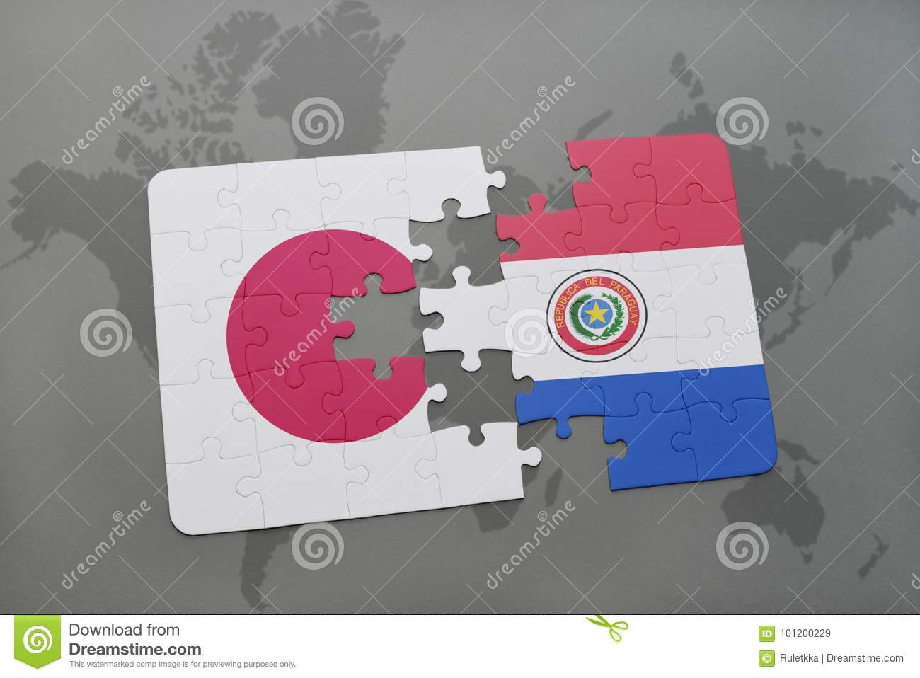 puzzle with the national flag of japan and paraguay on a world map background.