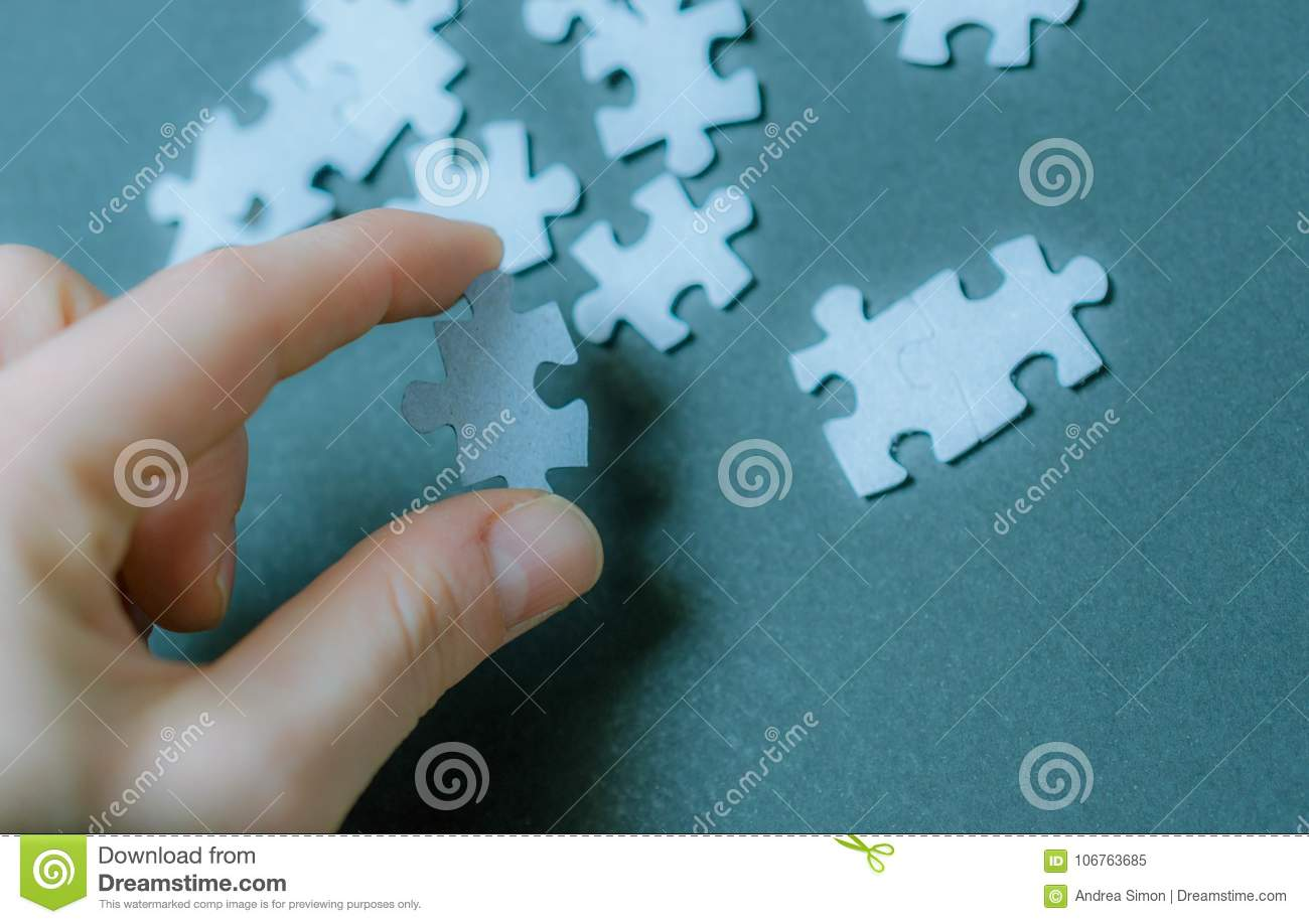 Puzzle piece in hand