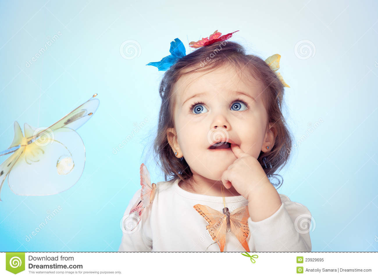Puzzled Baby Girl Royalty Free Stock Photo - Image: 23929695