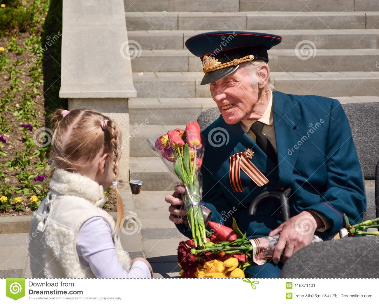 PYATIGORSK, RUSSIA - MAY 09, 2011: Girl gives flowers to veteran on Victory Day.