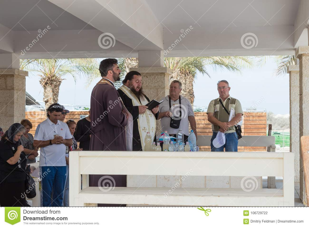 Christian priests pray in the presence of believers on the tourist site Qasr el Yahud in Israel