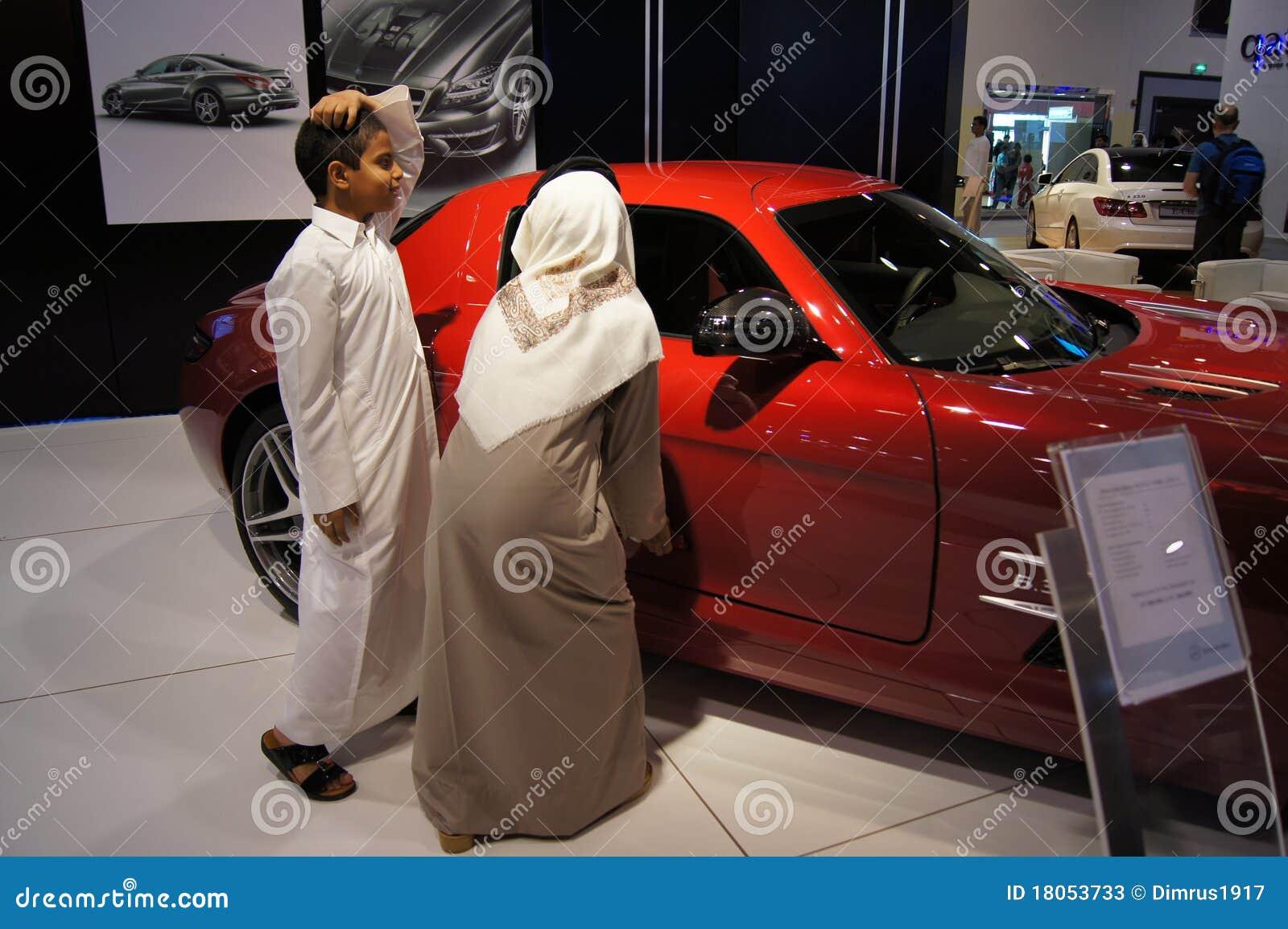 Qatar Motorshow 2011 Arab Boys Near Mercedes Editorial