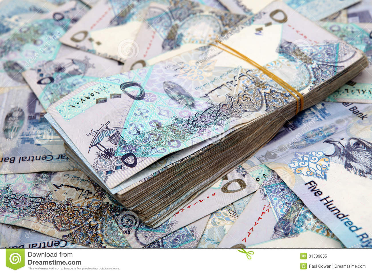 big pile of very high-value Qatari banknotes, each one worth about $ ...