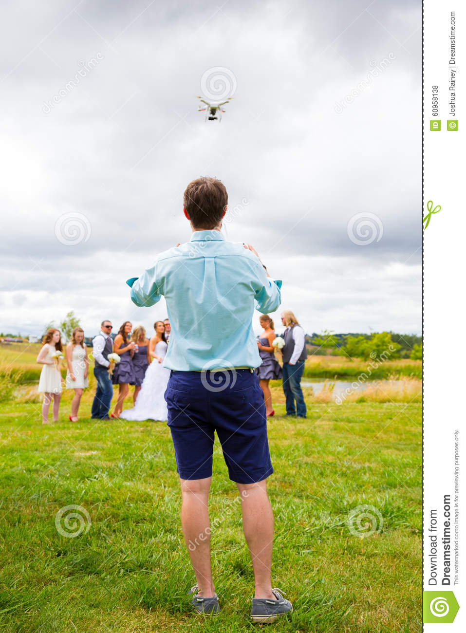 Quad Copter Pilot Flying Drone At Wedding Editorial Stock Photo