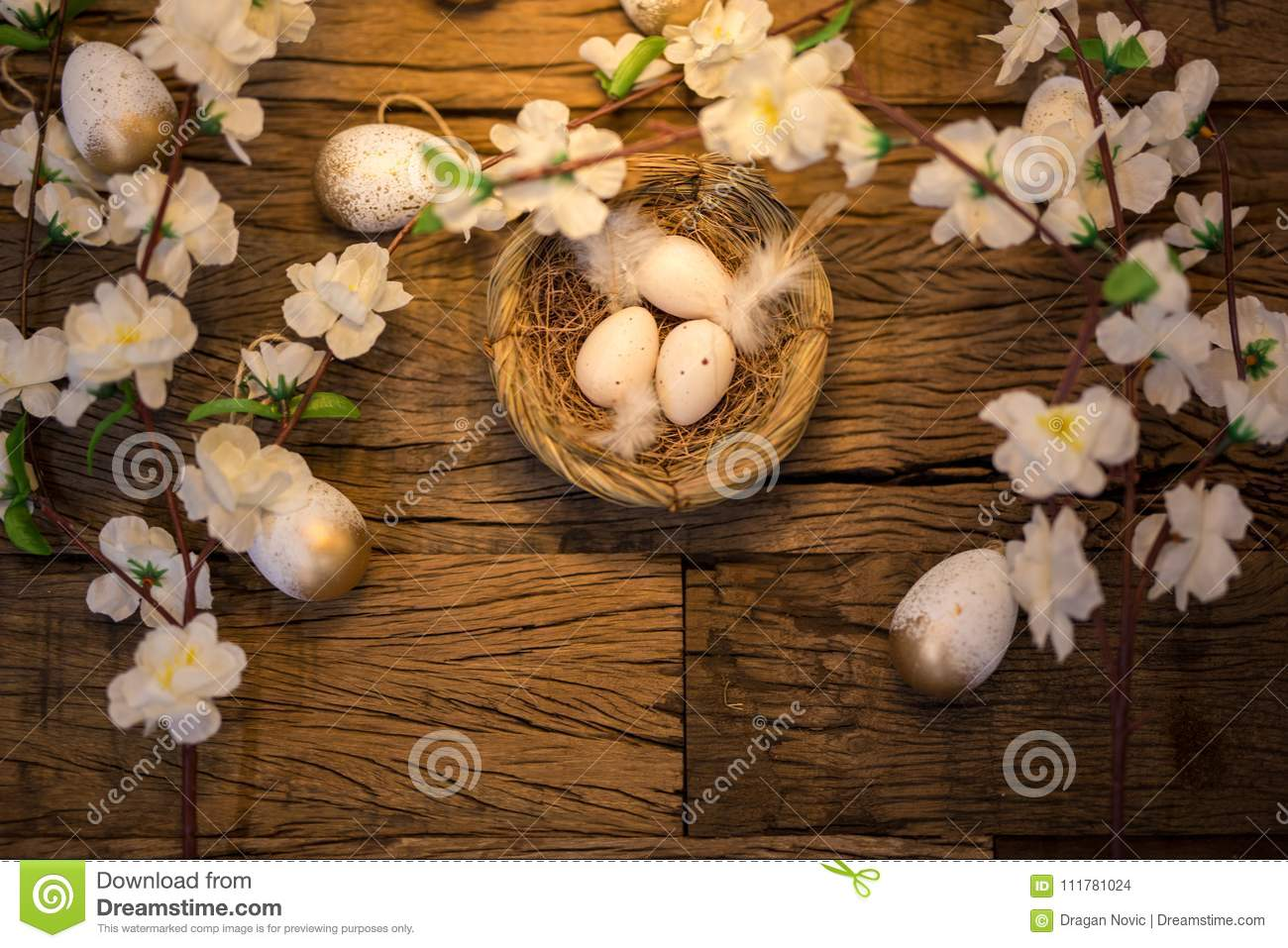 Quail eggs in a birds nest on a rustic wooden background