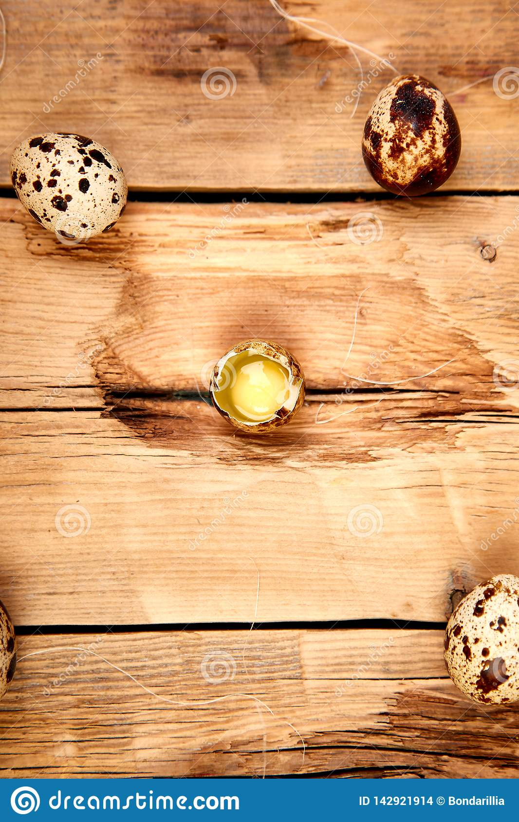 Quail eggs on wooden background. Happy easter