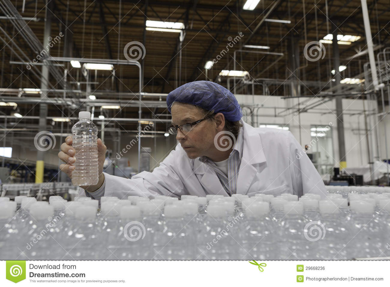 Quality Control Worker Checking Bottled Water At Bottling Plant ...