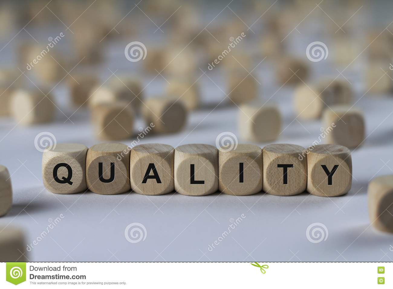Quality - cube with letters, sign with wooden cubes
