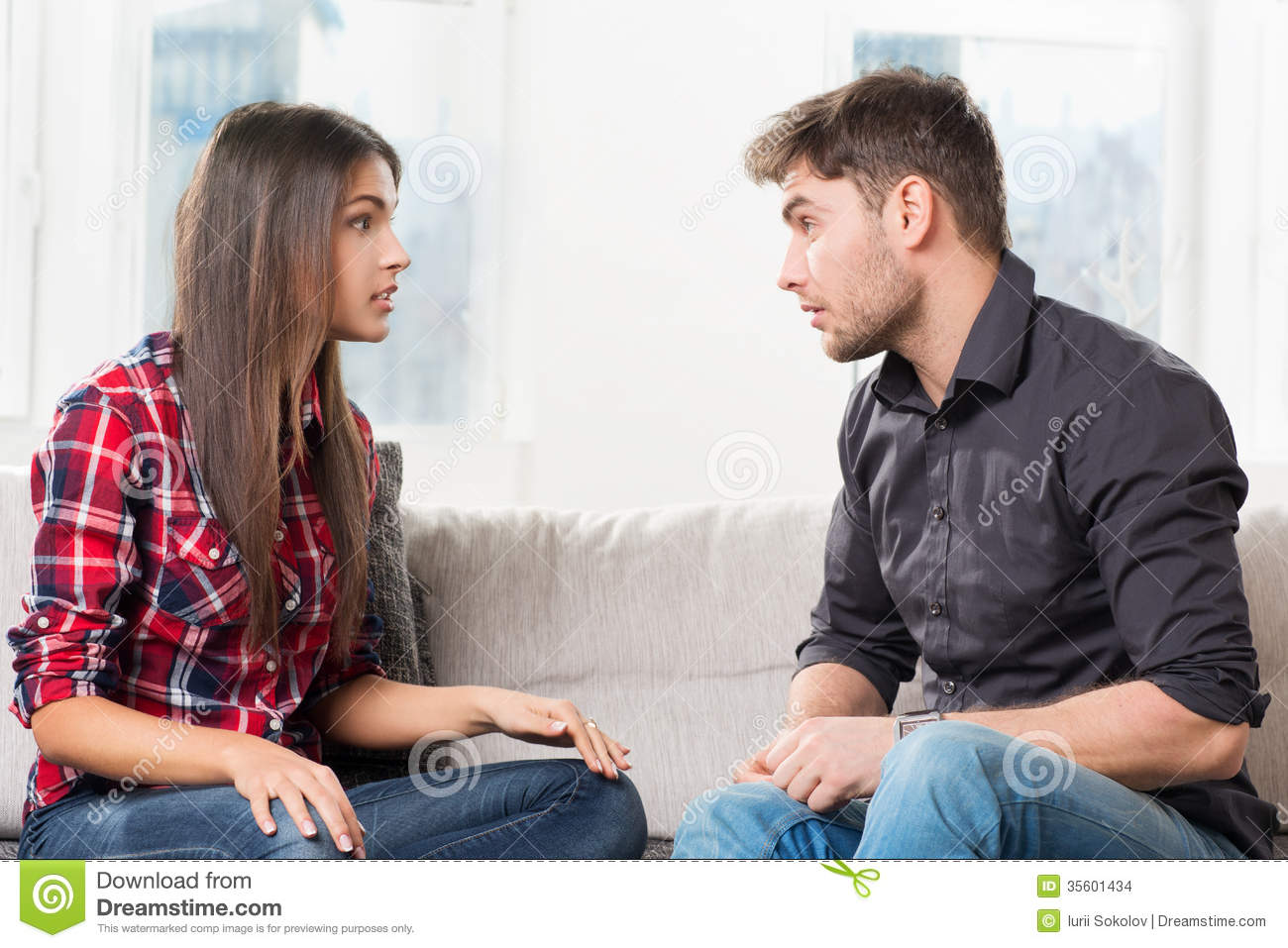 Quarreled couple in their living room stock images image for Living room ideas young couples