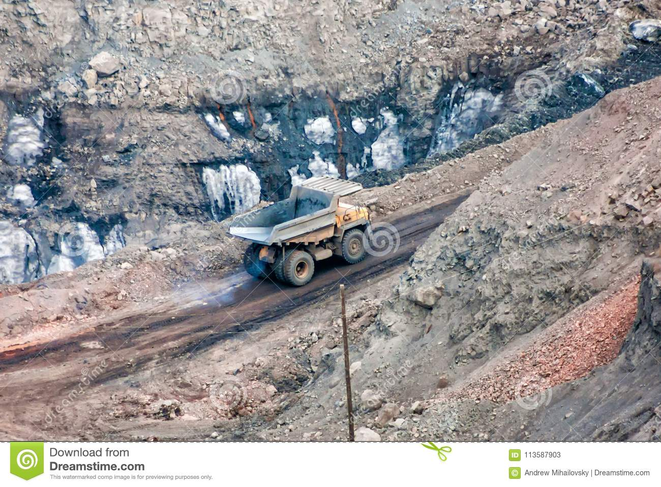 The quarry dump truck in the mine