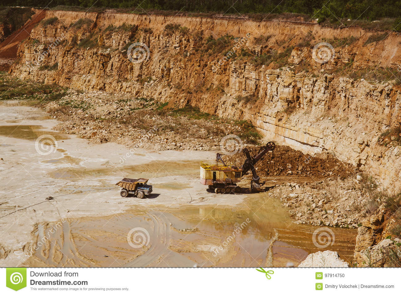 Quarry Truck And Quarry Excavator Machine Works In Limestone