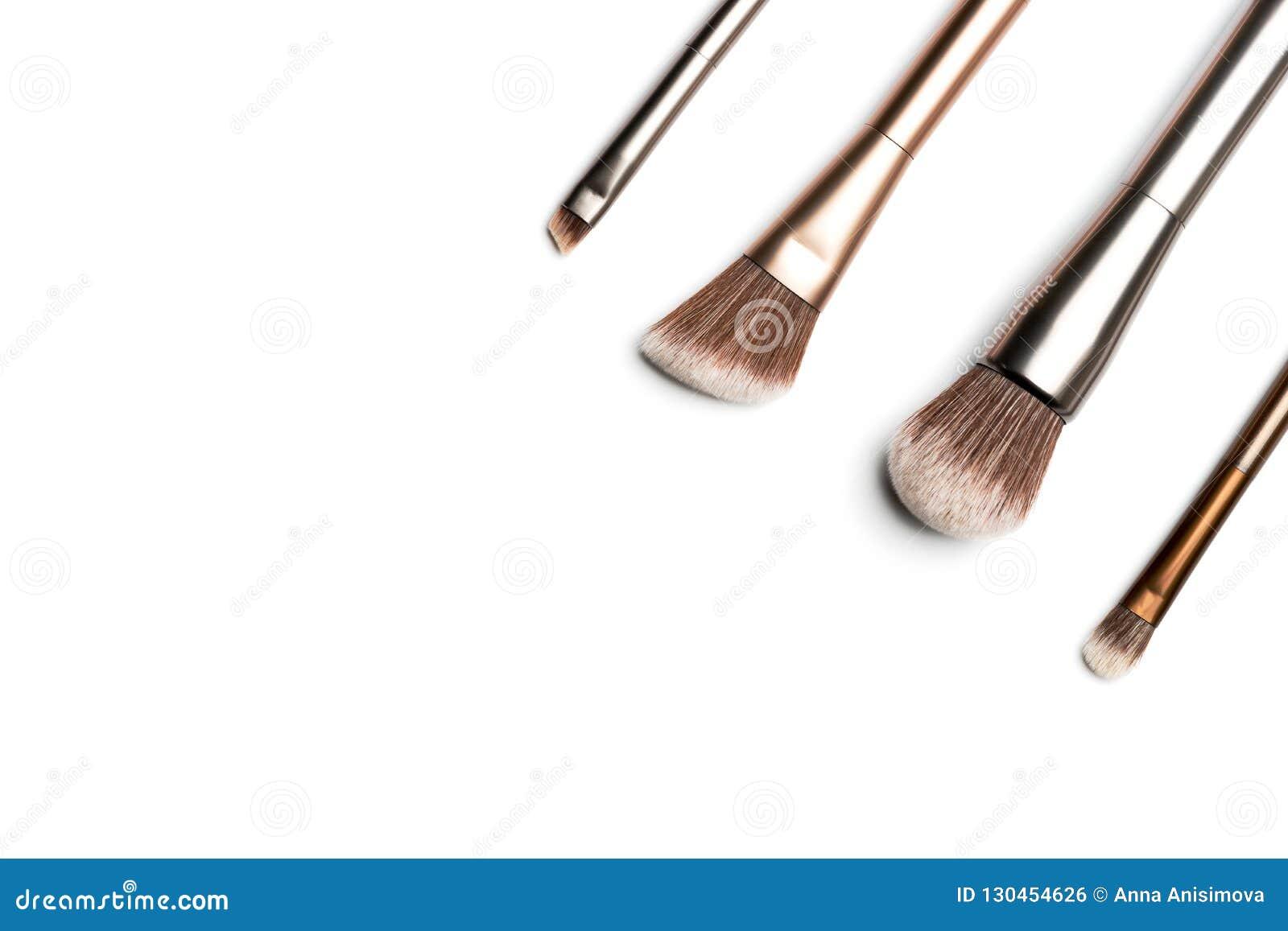 Quatro escovas de bronze e prata-coloridas brilhantes da composição para o applyi