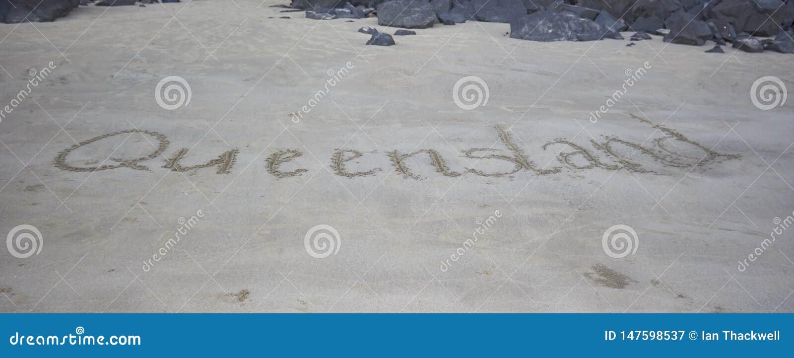 Queensland som är skriftlig i sanden