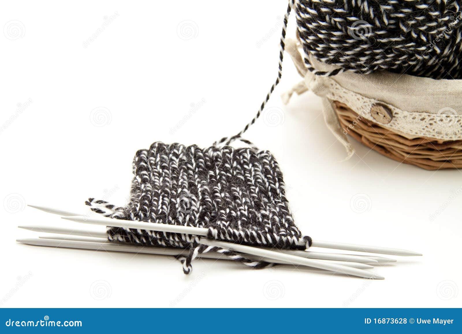 Queira com agulhas de confecção de malhas