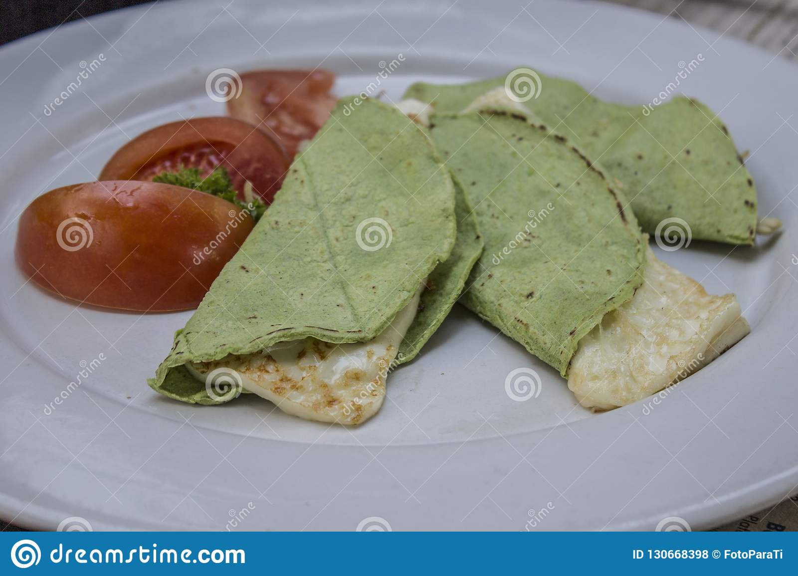 Quesadillas with green tortilla with panela cheese