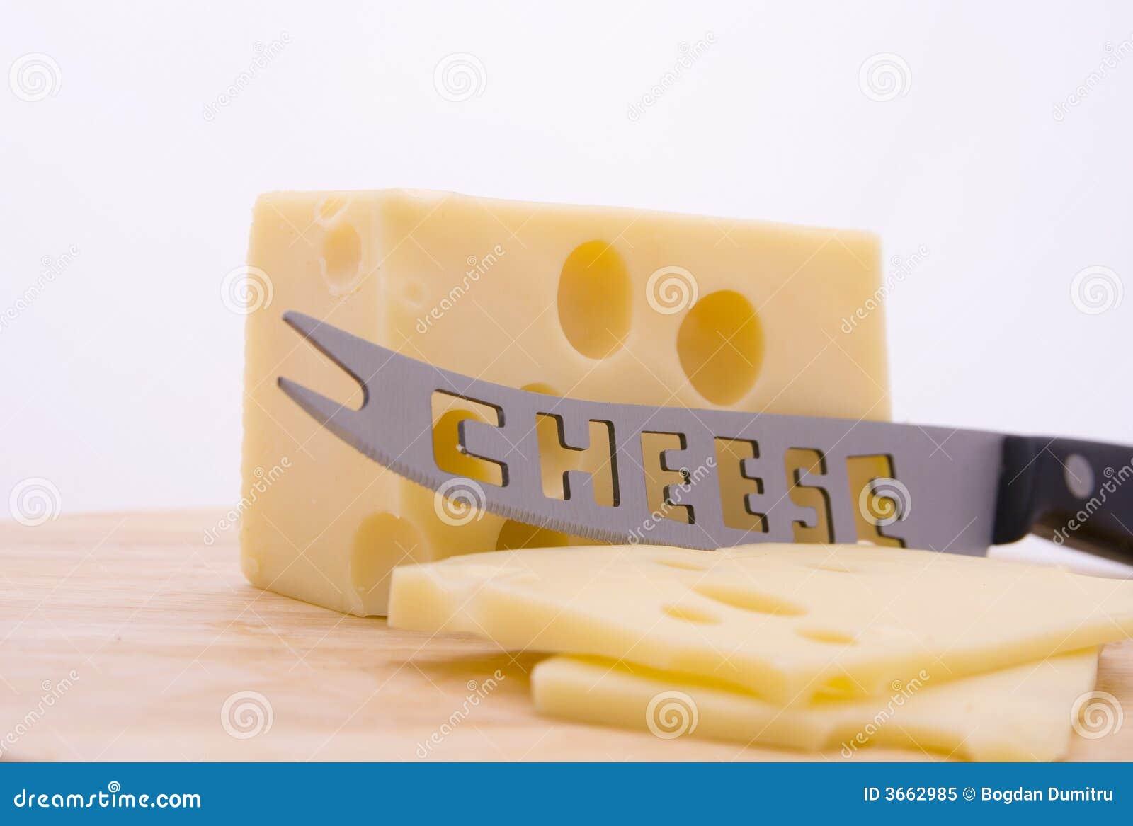 Queso y cuchillo en el borde foto de archivo libre de for Cuchillo queso el corte ingles