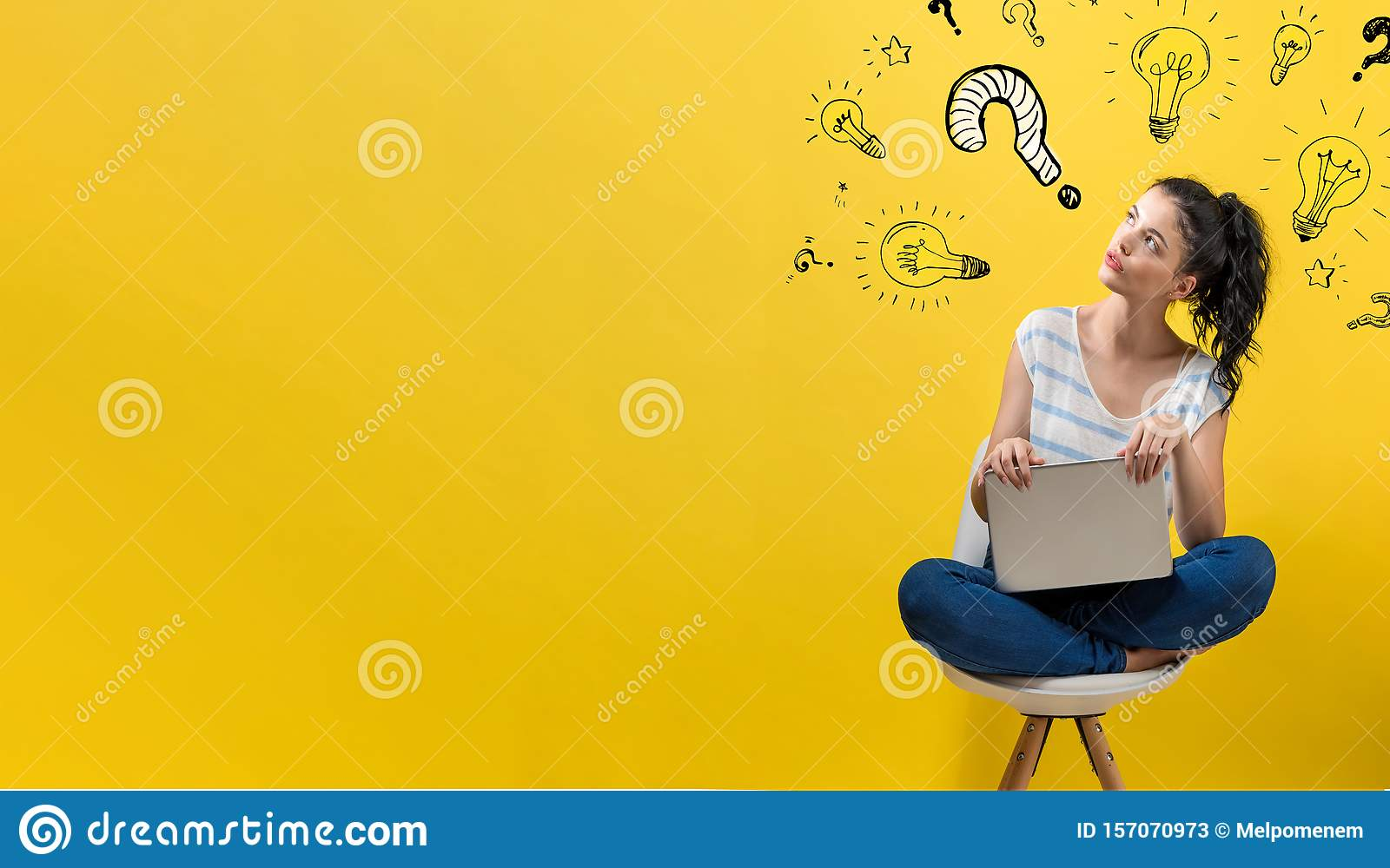 Question with light bulbs with woman using a laptop