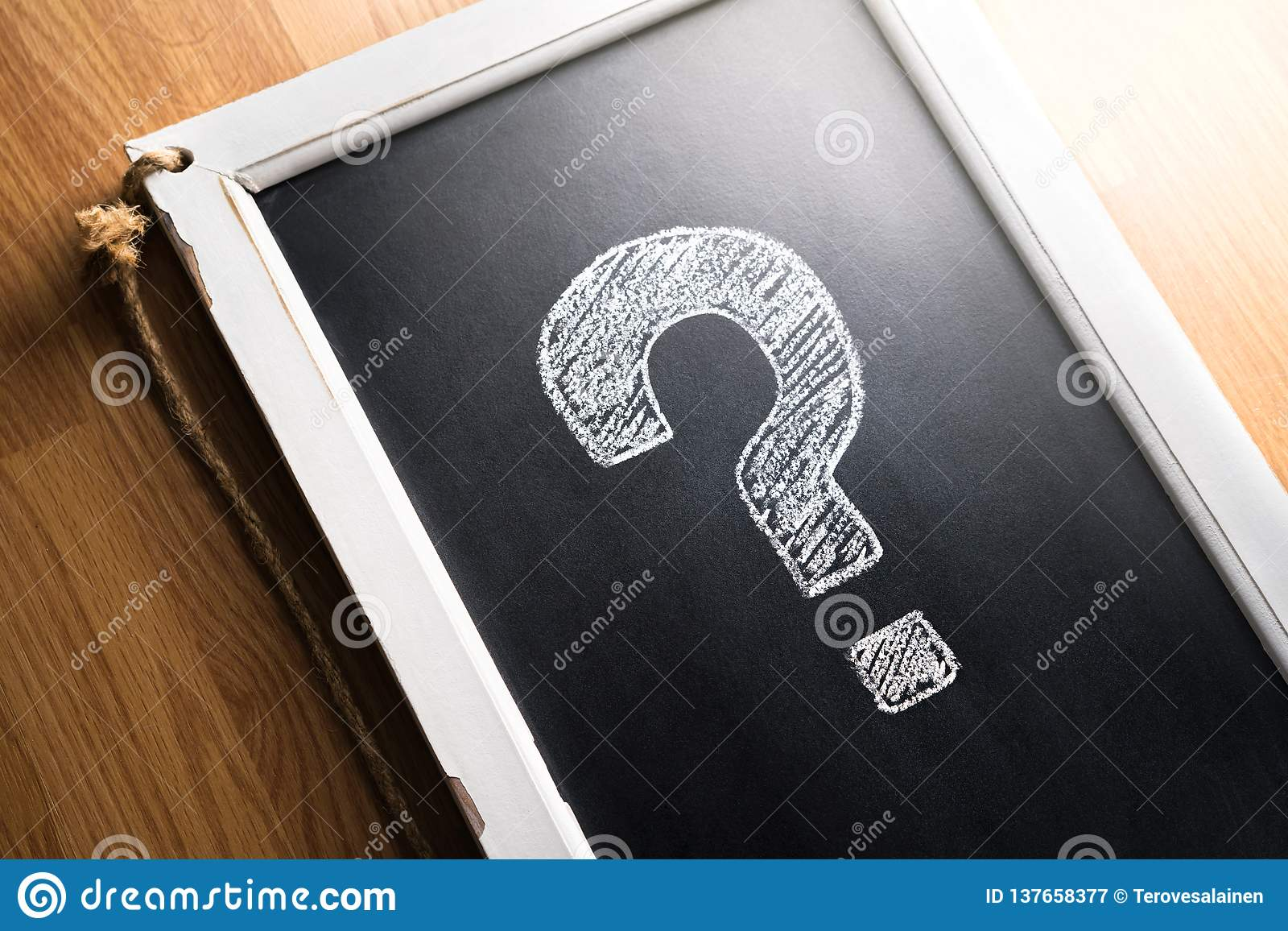 Question mark drawn on chalkboard. About us, help or info for business. Survey, poll or quiz concept. Punctuation, decision.