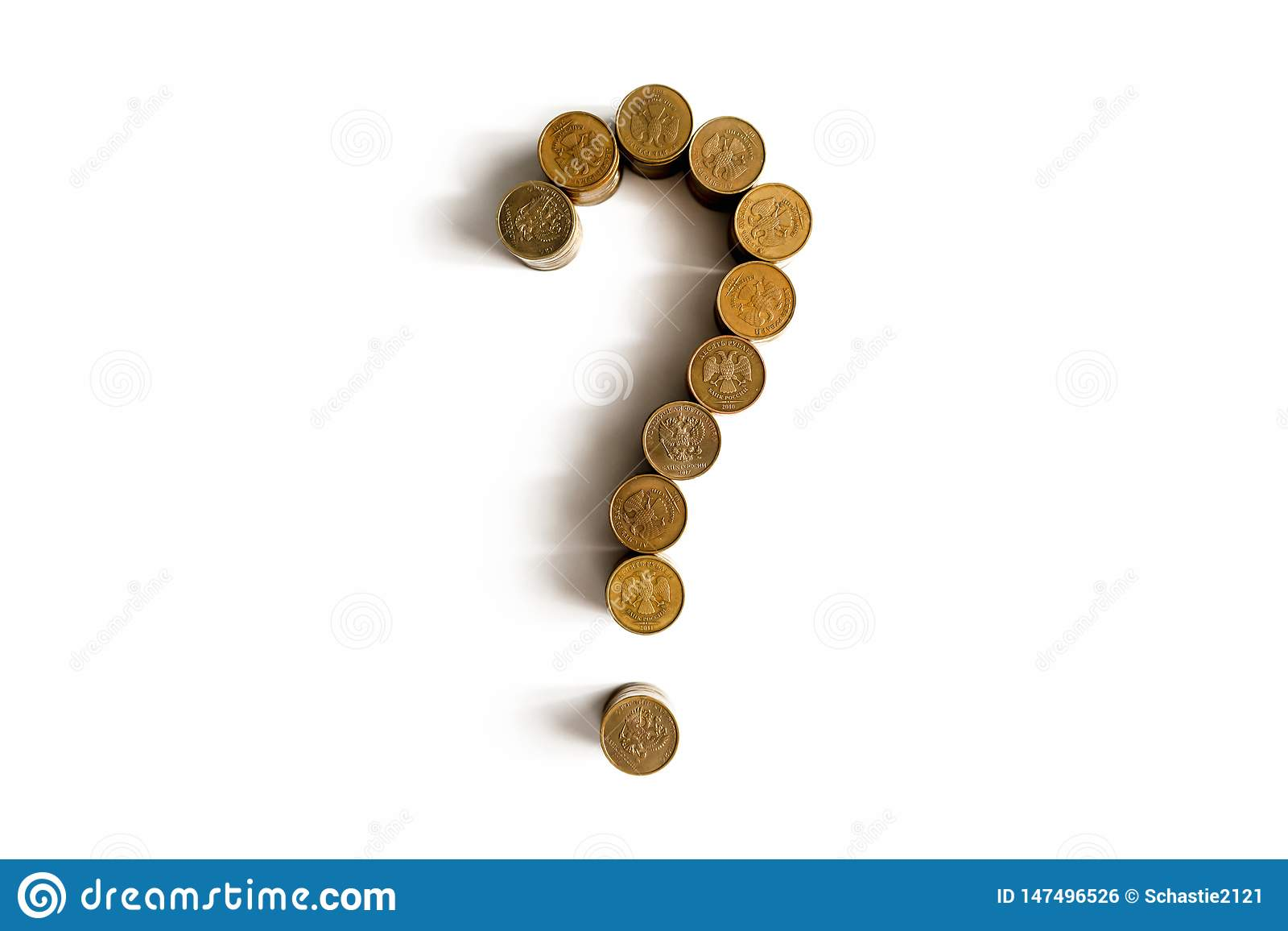 Question mark made of coins on a white background