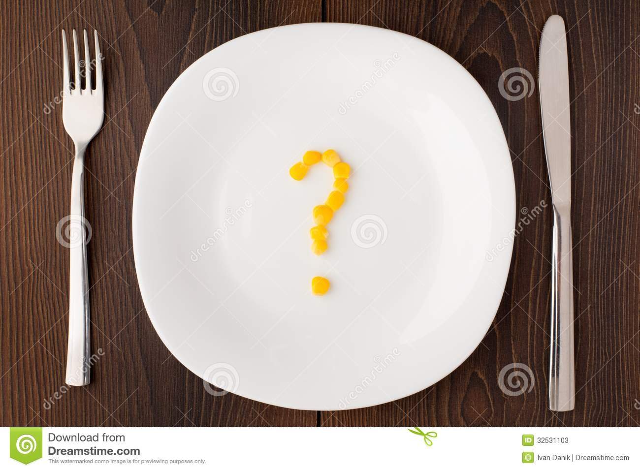 Question Mark Made Of Corn Seeds On Plate Stock Image