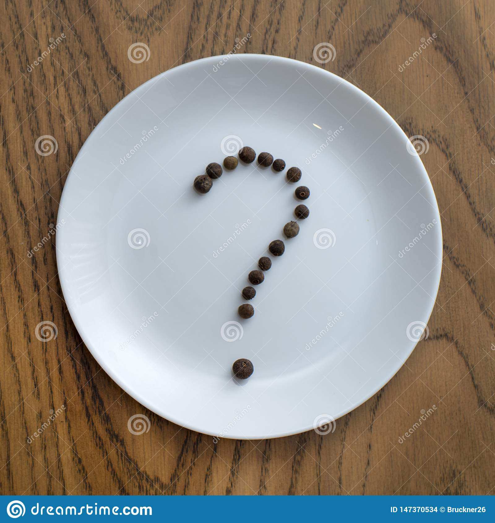 Question mark made of pepper