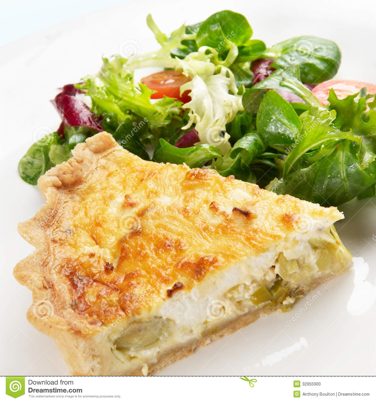 ... of leek and goats cheese quiche on a plate with crispy leaf salad
