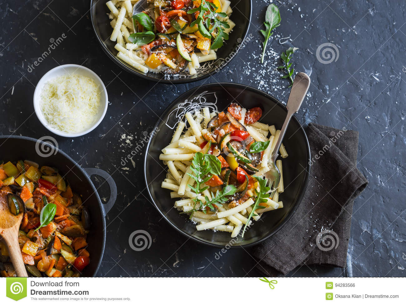 Quick ratatouille pasta. Delicious vegetarian healthy food concept. On a dark background