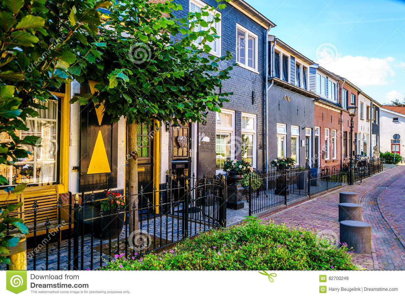 Quiet street in the historic Dutch Fishing Village of Bunschoten-Spakenburg with Renovated Row Houses