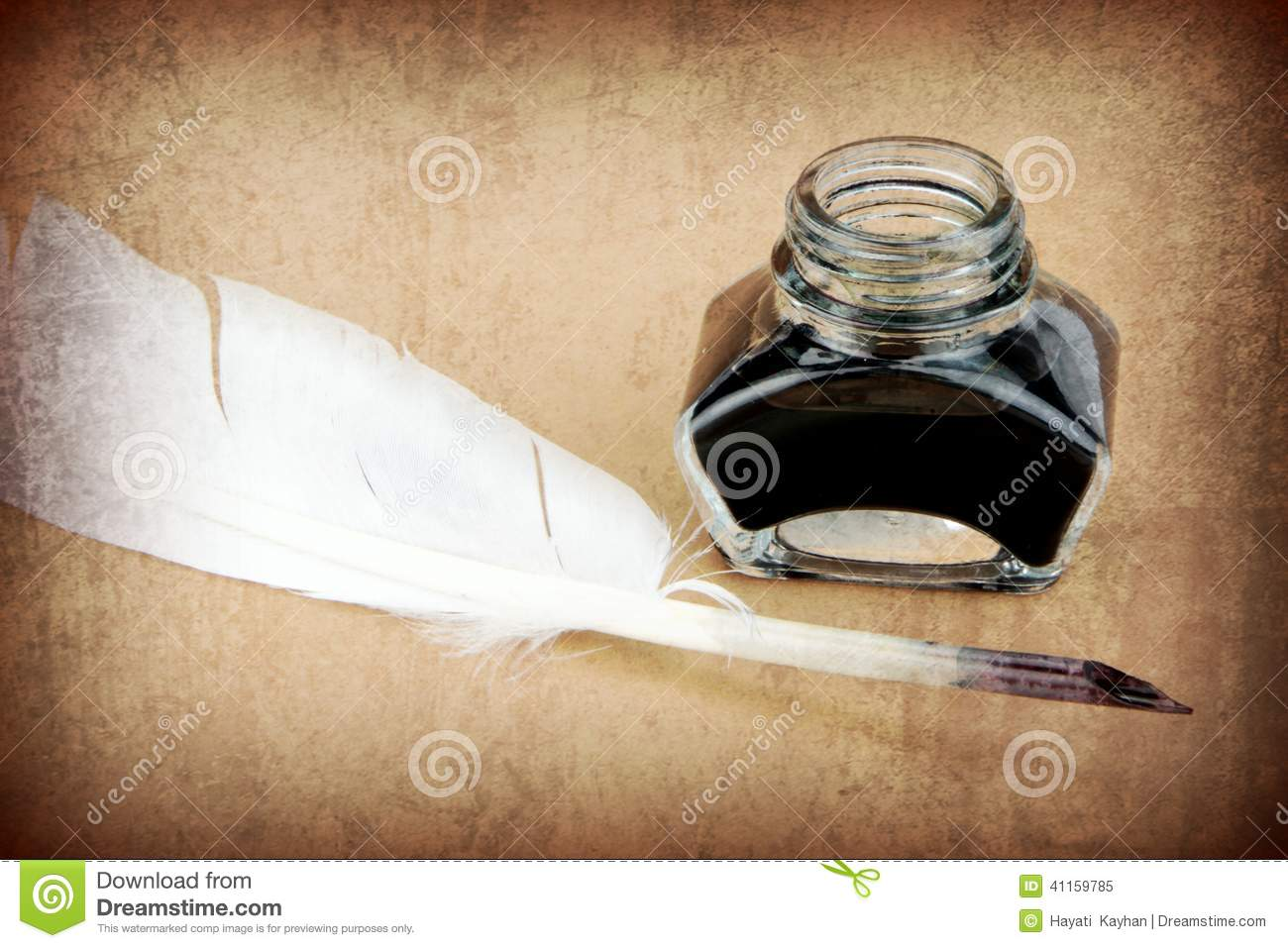 Quill pen and ink bottle