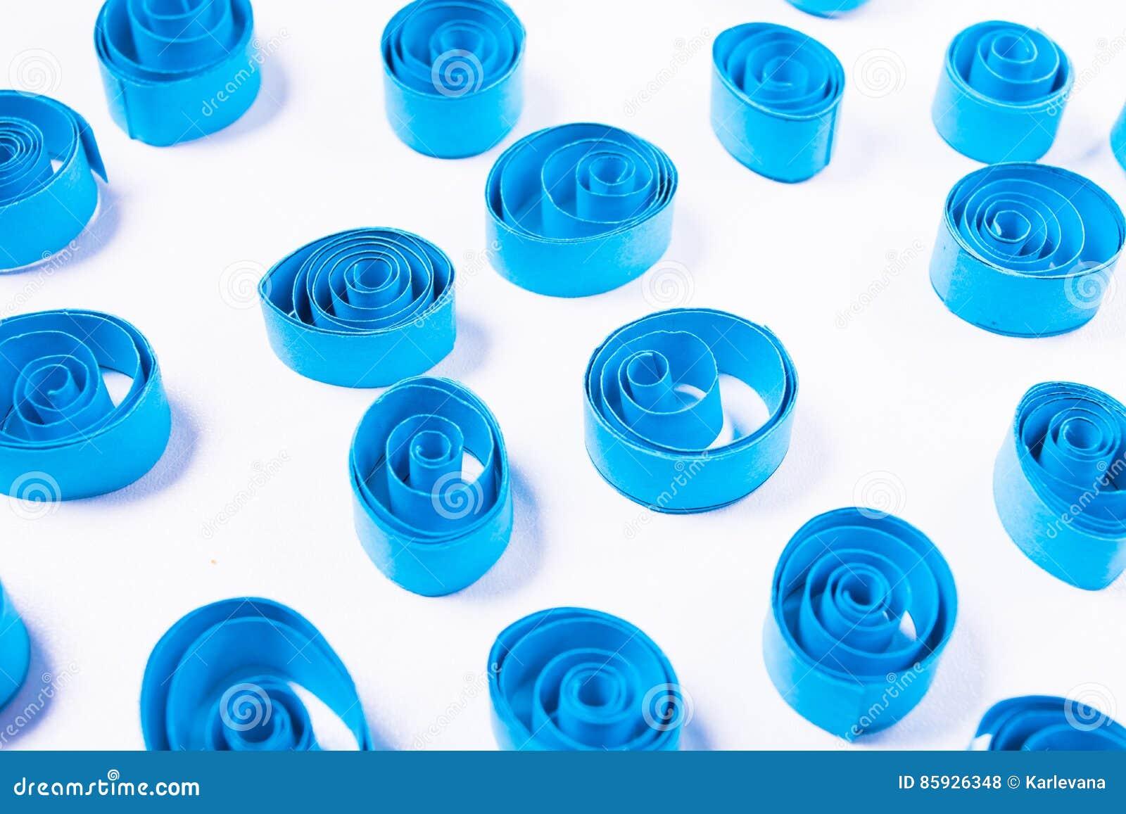 Quilling art. Blue paper curls